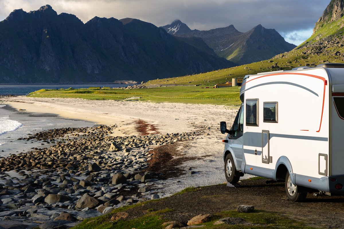 RV on the Norwegian coast, mountains in the background