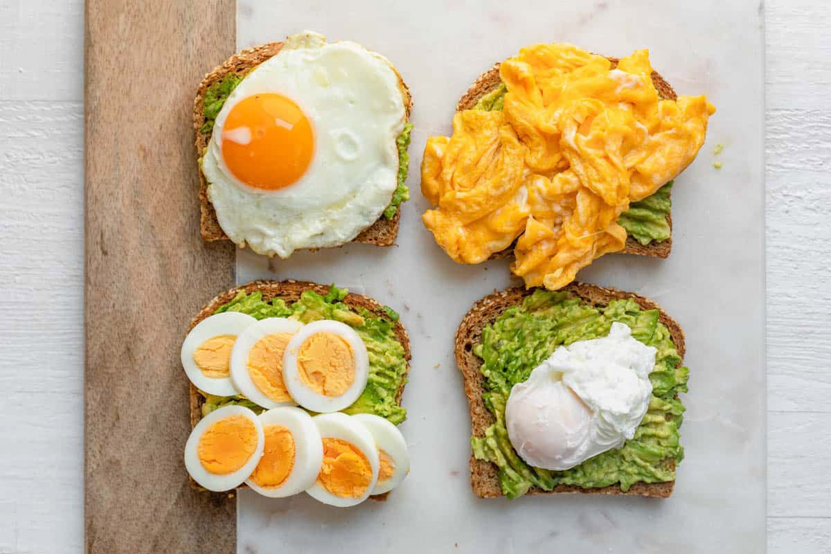 Avocado toast is displayed four ways with eggs.