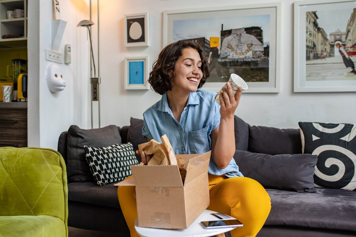 A woman unboxes things she bought online.