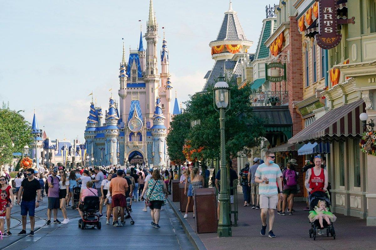 Guests stroll along Main Street at the Magic Kingdom theme park at Walt Disney World.