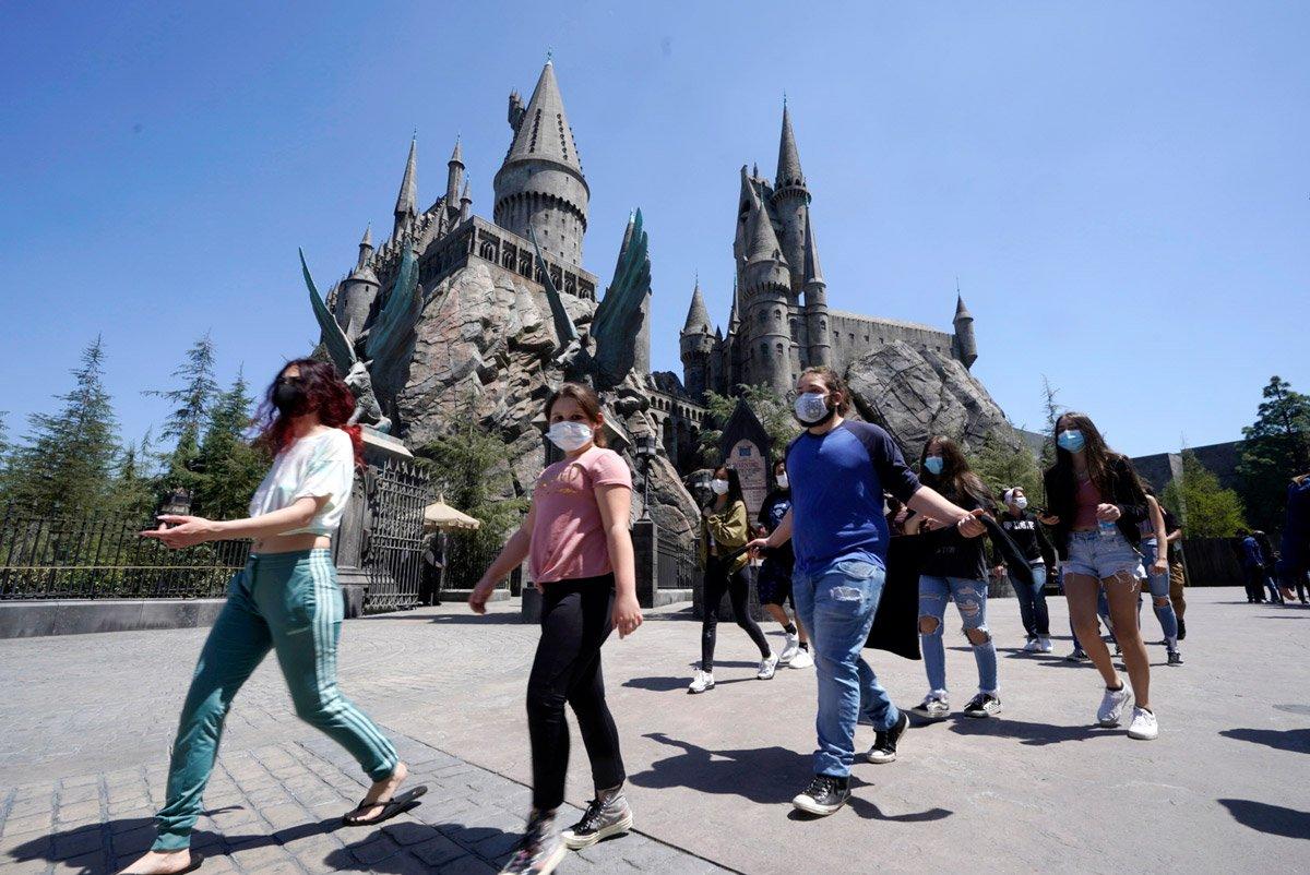 People walk around Wizarding World of Harry Potter.