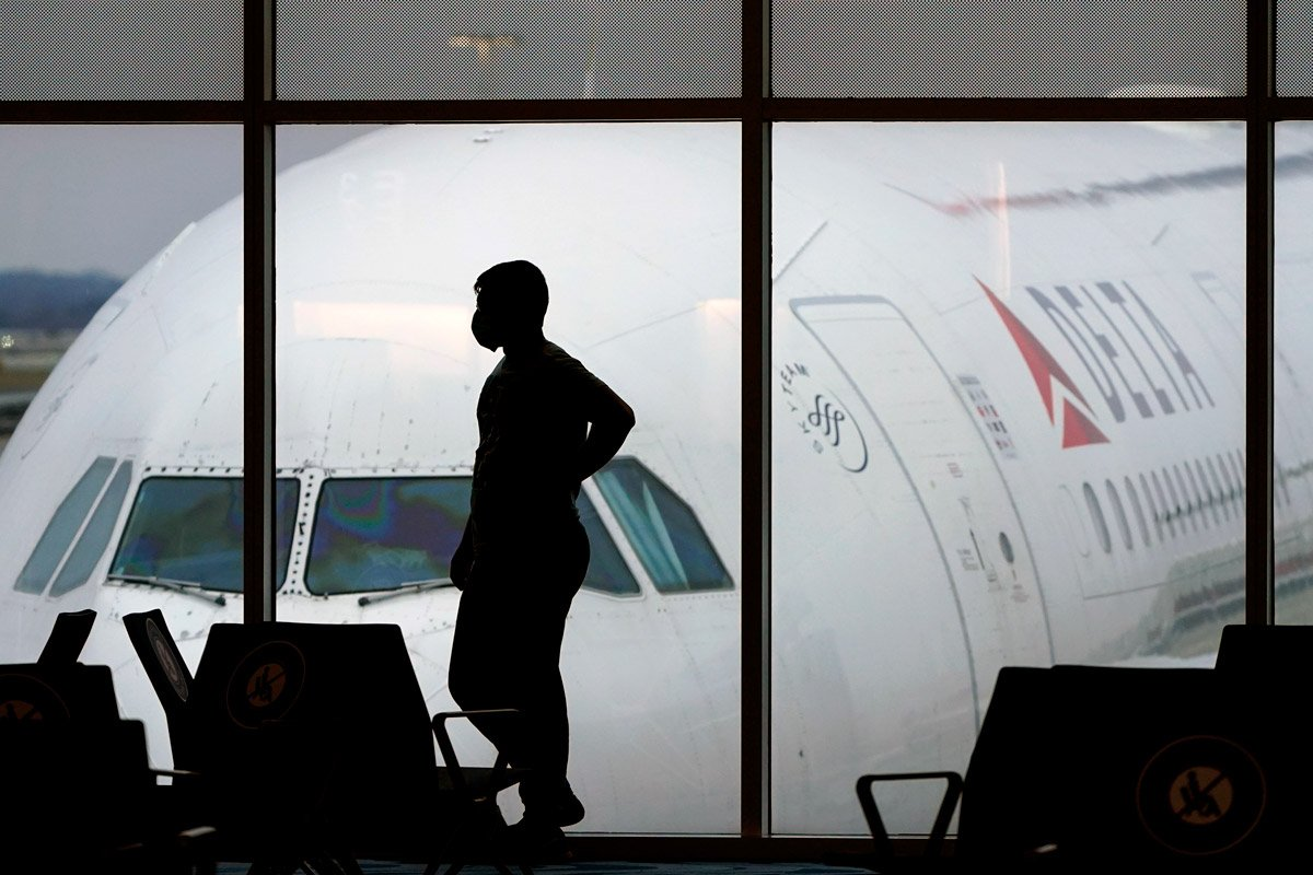 A passenger waits for a Delta Airlines flight at an airport.