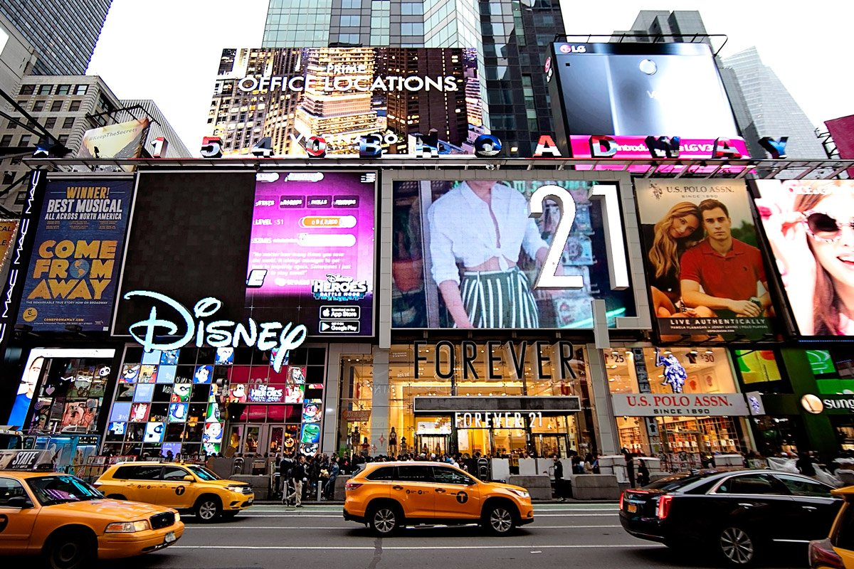 Stores line up in Time Square including Forever21 and Disney.