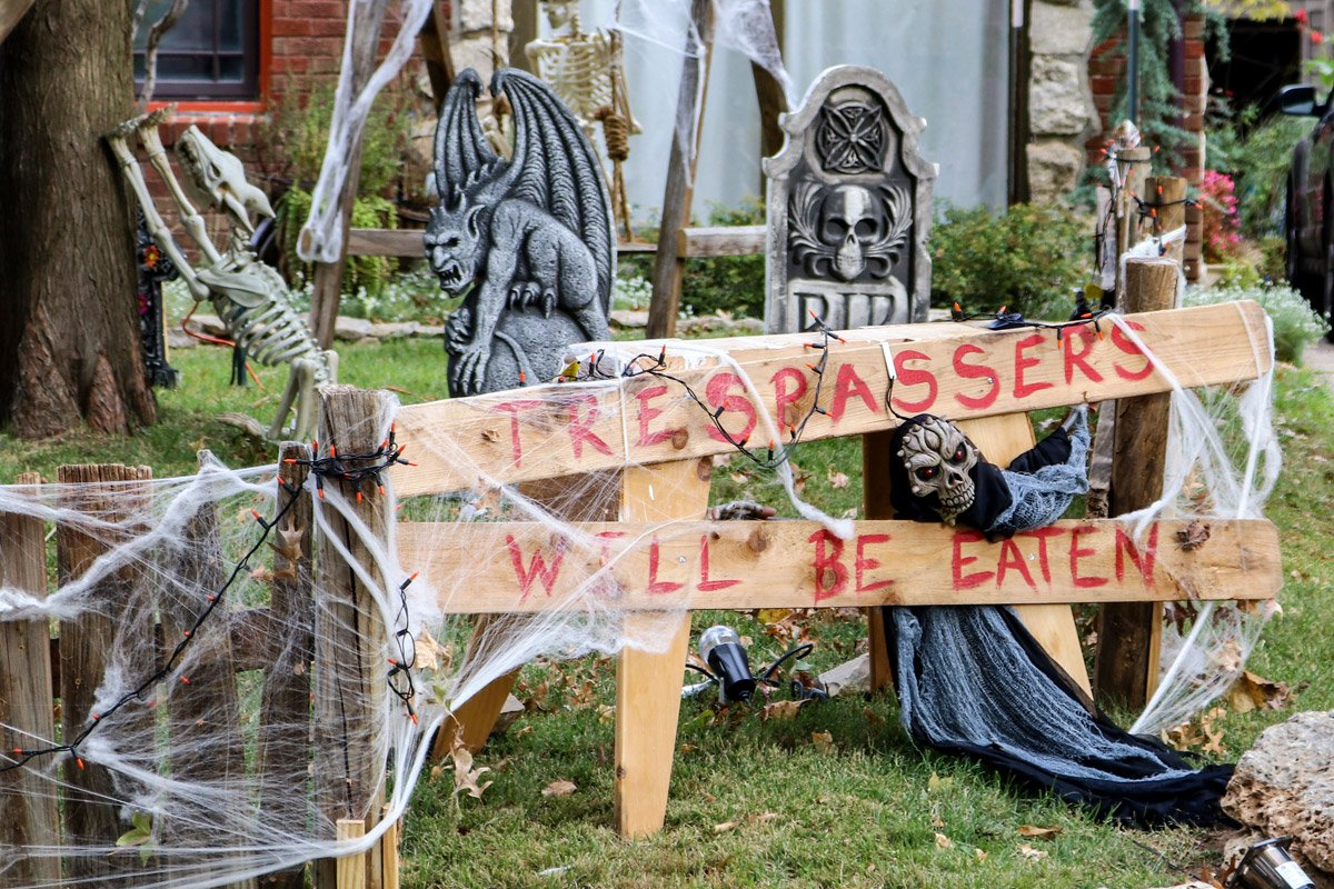 A graveyard in someone's yard on Halloween.