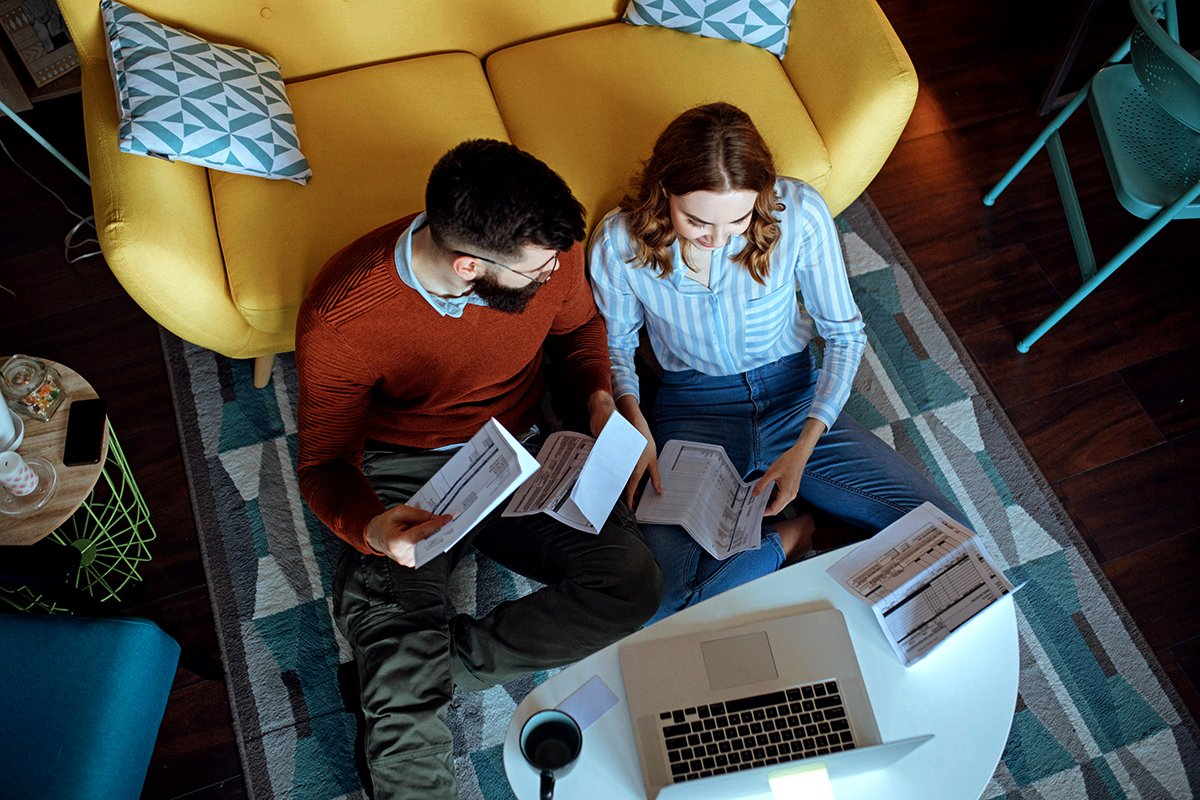 Couple looking at new orders and bills